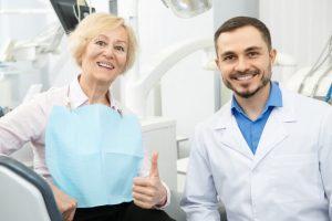 The senior patient has successful dental surgery.