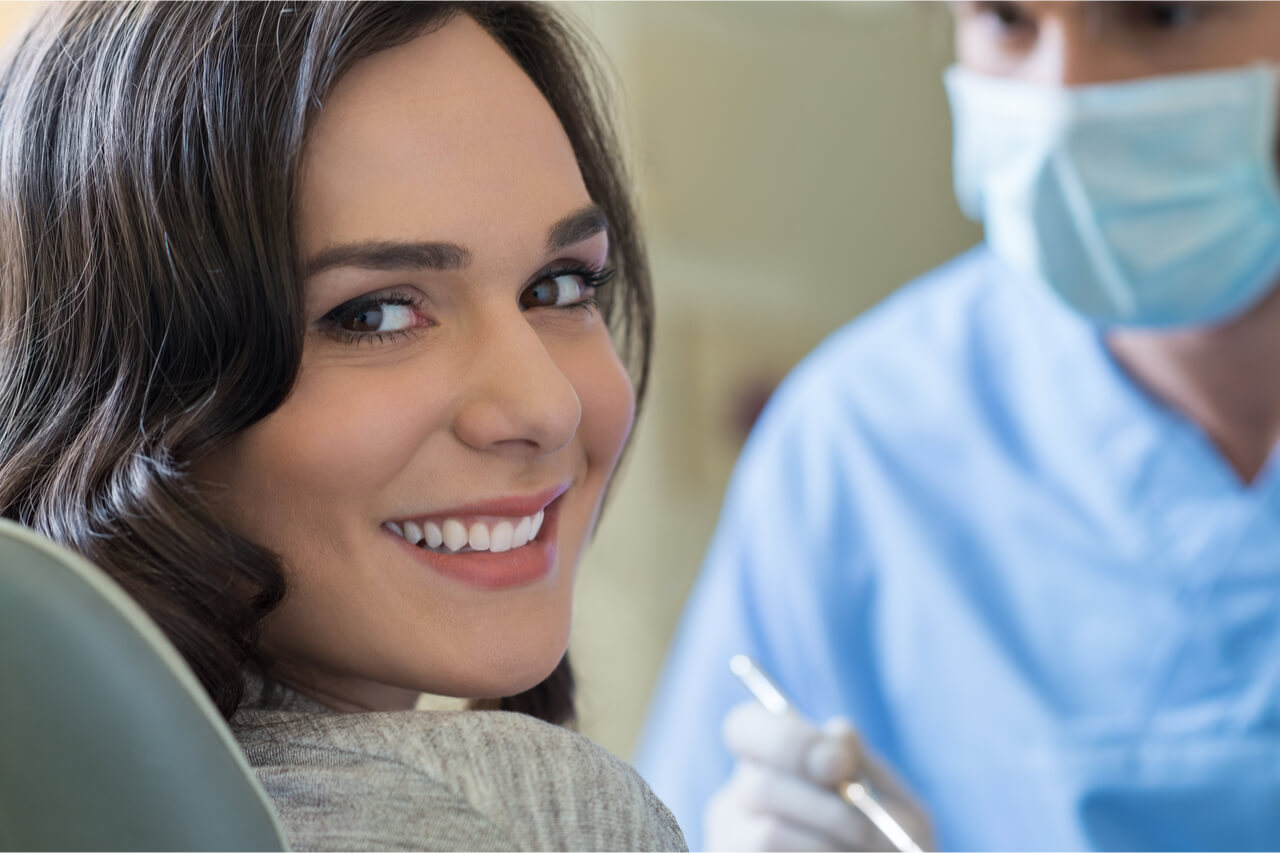The patient visits her dentist regularly.