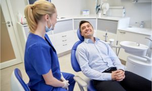 The dentist explains the initial procedure before proceeding to dental implant surgery.