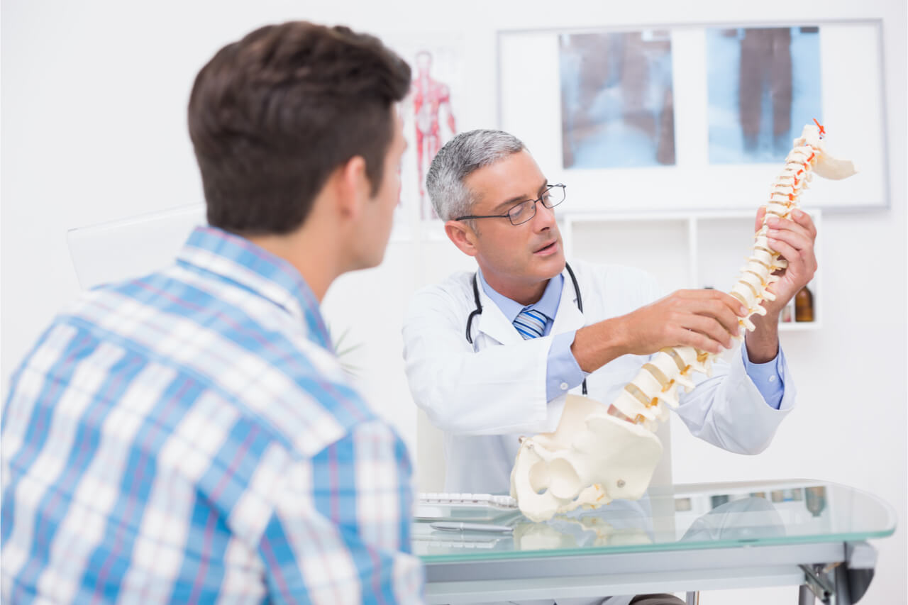 The doctor explains why the patient is experiencing back pain.
