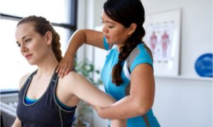 The therapist explains the sports injury treatment.